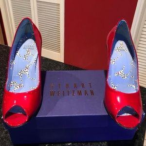 Women's Stuart Weitzman red metallic shoes. 8M
